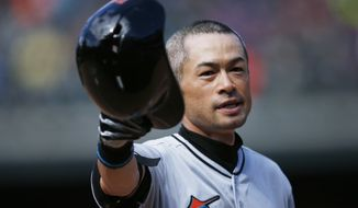 Miami Marlins' Ichiro Suzuki tips his batting helmet to the crowd as fans applaud after he hit a triple off Colorado Rockies relief pitcher Chris Rusin in the seventh inning of a baseball game, Sunday, Aug. 7, 2016 in Denver. The hit was the 3,000th in his Major League career. (AP Photo/David Zalubowski)