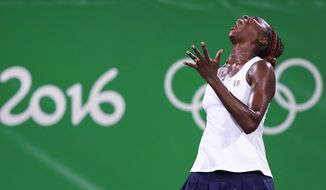 CORRECTS SPELLING OF LAST NAME TO SAFAROVA INSTEAD OF SARFAROVA - Venus Williams, of the United States, reacts after losing a point in a doubles match with her sister Serena against Lucie Safarova and Barbora Strycova, of the Czech Republic, at the 2016 Summer Olympics in Rio de Janeiro, Brazil, Sunday, Aug. 7, 2016. (AP Photo/Charles Krupa)