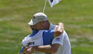 Jim Furyk celebrates with his caddy Mike, Fluff, Cowan after shooting a PGA record 58 during the final round of the Travelers Championship golf tournament in Cromwell, Conn., Sunday, Aug. 7, 2016. (AP Photo/Fred Beckham)