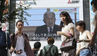 A screen displays Japanese Emperor Akihito delivering a speech in Tokyo, Monday, Aug. 8, 2016. The Japanese emperor, in a rare address to the public, signaled Monday his apparent wish to abdicate by expressing concern about his ability to carry out his duties fully. (AP Photo/Koji Sasahara)