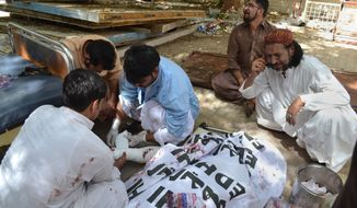 A Pakistani man mourns the death of a family member who was killed in a bomb blast, in Quetta, Pakistan, Monday, Aug. 8, 2016. A powerful bomb went off inside a government-run hospital in the southwestern city of Quetta on Monday, killing dozens of people and wounding dozens of others, police said. (AP Photo/Arshad Butt)
