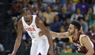 United States' Kevin Durant (5) moves the ball around Venezuela's Dwight Lewis (2) during a men's basketball game at the 2016 Summer Olympics in Rio de Janeiro, Brazil, Monday, Aug. 8, 2016. (AP Photo/Eric Gay)