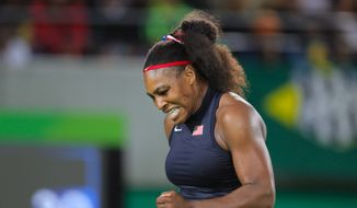 Serena Williams of the United States celebrates after defeating France's Alize Cornet in the women's tennis competition at the 2016 Summer Olympics in Rio de Janeiro, Brazil, Monday, Aug. 8, 2016. (AP Photo/Vadim Ghirda)