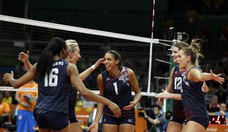 Team United States celebrates during a women's preliminary volleyball match against the Netherlands at the 2016 Summer Olympics in Rio de Janeiro, Brazil, Monday, Aug. 8, 2016. (AP Photo/Matt Rourke)