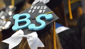 A University of Wisconsin-Stout student attends a graduation ceremony in May. (Facebook, University of Wisconsin-Stout)