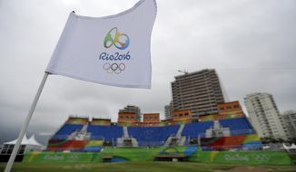 The flag on the 18th hole waves in the wind on the Olympic golf course at the 2016 Summer Olympics in Rio de Janeiro, Brazil, Sunday, Aug. 7, 2016. (AP Photo/Robert F. Bukaty)