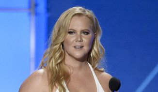 In this Jan. 17, 2016, file photo, Amy Schumer accepts the Critics' Choice MVP award at the 21st annual Critics' Choice Awards in Santa Monica, Calif. (Photo by Chris Pizzello/Invision/AP, File)