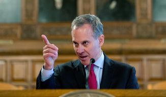 "New York Attorney General Eric T. Schneiderman continued his crusade against energy giant Exxon, saying that no company, ""no matter how rich or powerful,"" is above the law. (Associated Press)"
