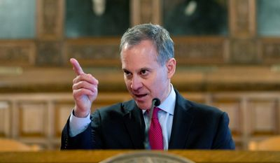 """New York Attorney General Eric T. Schneiderman continued his crusade against energy giant Exxon, saying that no company, """"no matter how rich or powerful,"""" is above the law. (Associated Press)"""