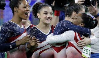 U.S. gymnasts, left to right, Gabrielle Douglas, Lauren Hernandez, Aly Raisman and Simone Biles celebrate at the end of the artistic gymnastics women's team final at the 2016 Summer Olympics in Rio de Janeiro, Brazil, Tuesday, Aug. 9, 2016.(AP Photo/Charlie Riedel)