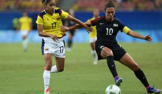 United States' Carli Lloyd, right, and Colombia's Carolina Arias fight for the ball during a group G match of the women's Olympic football tournament between Colombia and United States at the Arena Amazonia stadium in Manaus, Brazil, Tuesday, Aug. 9, 2016. (AP Photo/Michael Dantas)