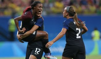 United States' Crystal Dunn, left, celebrates scoring her side's first goal with teammates during a group G match of the women's Olympic football tournament between Colombia and United States at the Arena Amazonia stadium in Manaus, Brazil, Tuesday, Aug. 9, 2016. (AP Photo/Michael Dantas)