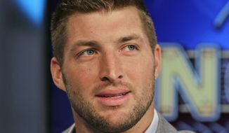 FILE - In this Aug. 6, 2014, file photo, Tim Tebow ponders a question during an interview on the set of ESPN's new SEC Network in Charlotte, N.C. With professional football not working out, Tebow is going to give baseball a try. The 2007 Heisman Trophy winner and former NFL first-round draft pick plans to hold a workout for Major League Baseball teams this month. Tebow last played organized baseball in high school. ESPN first reported the news. (AP Photo/Chuck Burton, File)
