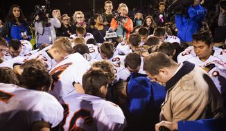 Coach Joe Kennedy started praying after games when he was hired as an assistant varsity football coach at Bremerton High School in Washington state in 2008. At first, the prayers were solitary. Eventually, players began asking Mr. Kennedy whether they could join. Mr. Kennedy said he neither encouraged nor discouraged students from participating. (Associated Press)