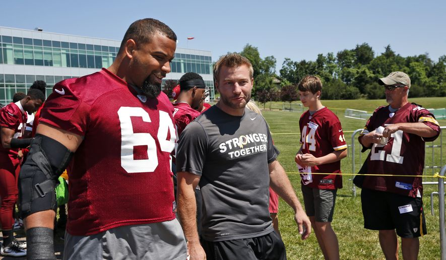 Washington Redskins nose tackle Kedric Golston (64) and offensive coordinator Sean McVay talk as they walk to practice at the team's NFL football training facility at Redskins Park, Wednesday, June 8, 2016 in Ashburn, Va. (AP Photo/Alex Brandon)