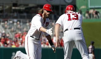 Washington Nationals' Jayson Werth, left, is congratulated by third base coach Bob Henley (13) as he rounds the bases for his three-run homer during the second inning of a baseball game against the Cleveland Indians at Nationals Park, Wednesday, Aug. 10, 2016, in Washington. (AP Photo/Alex Brandon)