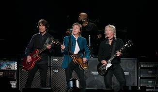 Paul McCartney performs with his band at Verizon Center.  (Erica Bruce)