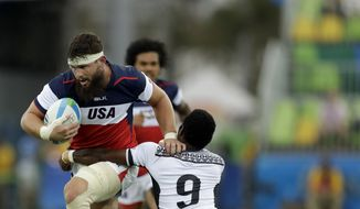 United States's Danny Barrett, left, is challenged by Fiji's Jerry Tuwai, during the men's rugby sevens match at the Summer Olympics in Rio de Janeiro, Brazil, Wednesday, Aug. 10, 2016. (AP Photo/Themba Hadebe)