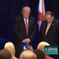 Flanked by Mike Huckabee, Donald Trump prays at an Americans Renewal Project event for 700 faith leaders in Florida on Thursday. (C-SPAN)