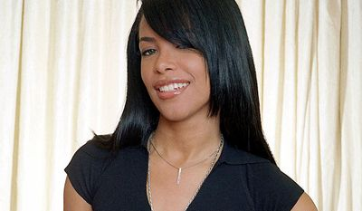 """Aaliyah (January 16, 1979 August 25, 2001) was born in Brooklyn, New York, and raised in Detroit, Michigan. At the age of 10, she appeared on the television show Star Search and performed in concert alongside Gladys Knight. At age 12, Aaliyah signed with Jive Records and her uncle Barry Hankerson's Blackground Records. Hankerson introduced her to R. Kelly, who became her mentor, as well as lead songwriter and producer of her debut album, Age Ain't Nothing but a Number. The album sold three million copies in the United States and was certified double platinum by the Recording Industry Association of America (RIAA). After facing allegations of an illegal marriage with R. Kelly, Aaliyah ended her contract with Jive and signed with Atlantic Records. Aaliyah worked with record producers Timbaland and Missy Elliott for her second album, One in a Million; it sold 3 million copies in the United States and over eight million copies worldwide. In 2000, Aaliyah appeared in her first film, Romeo Must Die. She contributed to the film's soundtrack, which spawned the single """"Try Again"""". The song topped the Billboard Hot 100 solely on airplay, making Aaliyah the first artist in Billboard history to achieve this goal. """"Try Again"""" earned Aaliyah a Grammy Award nomination for Best Female R&B Vocalist. After completing Romeo Must Die, Aaliyah filmed her role inQueen of the Damned. She released her third and final album, Aaliyah, in July 2001. On August 25, 2001, Aaliyah and eight others were killed in a plane crash in the Bahamas after filming the music video for the single """"Rock the Boat"""". The pilot, Luis Morales III, was unlicensed at the time of the accident and had traces of cocaine and alcohol in his system. (AP Photo)"""
