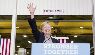 Democratic presidential candidate Hillary Clinton waves as she finishes a speech on the economy after touring Futuramic Tool & Engineering, in Warren, Mich., Thursday, Aug. 11, 2016. (AP Photo/Andrew Harnik)