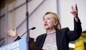 Hillary Clinton took pages from Mr. Obama's economic plans, echoing his calls for an infrastructure bank and a clean energy surge. (Associated Press)