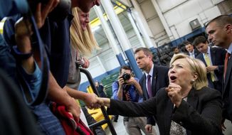 Democratic presidential candidate Hillary Clinton reacts while greeting supporters after giving a speech on the economy at Futuramic Tool & Engineering, in Warren, Mich., Thursday, Aug. 11, 2016. (AP Photo/Andrew Harnik)
