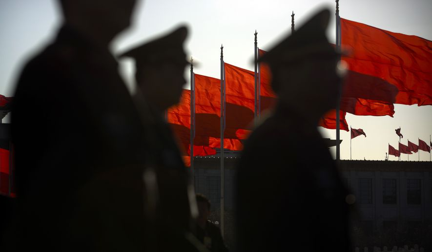 Chinese People's Liberation Army delegates arrive at the Great Hall of the People before a plenary session of the National People's Congress in Beijing on March 13. (Associated Press)