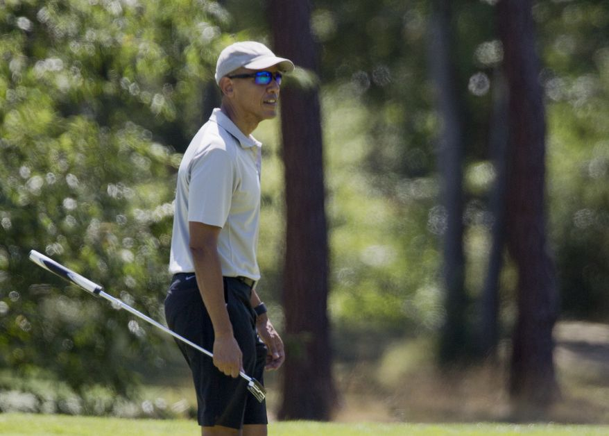 President Barack Obama walks to pick up his ball after putting on the first green during a round of golf at Farm Neck Golf Course in Oak Bluffs, Mass., on Martha's Vineyard, Sunday, Aug. 7, 2016.  (AP Photo/Manuel Balce Ceneta)