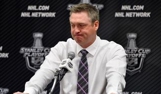 FILE - In this April 30, 2014, file photo, Colorado Avalanche head coach Patrick Roy talks during a news conference following Game 7 of an NHL hockey first-round playoff series against the Minnesota Wild, in Denver. Minnesota beat Colorado 5-4 to win the series. Patrick Roy has stepped down as coach and vice president of hockey operations for the Colorado Avalanche. Roy made the announcement Thursday, Aug. 11, 2016,  through a public relations agency, two months before the start of the NHL regular season. (AP Photo/Jack Dempsey, File)