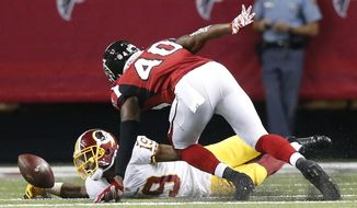 Washington Redskins wide receiver Rashad Ross (19) fumbles the ball as Atlanta Falcons defensive back Damian Parms (40) chases the ball during the second half of a preseason NFL football game, Thursday, Aug. 11, 2016, in Atlanta. The Washington Redskins recovered the ball. (AP Photo/Brynn Anderson)