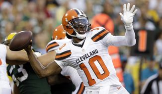 Cleveland Browns quarterback Robert Griffin III (10) throws against the Green Bay Packers in the first half of an NFL preseason football game in Green Bay, Wis., Friday, Aug. 12, 2016. (AP Photo/Jeffery Phelps)