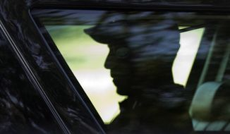President Barack Obama is seated in the presidential vehicle as his motorcade leaves Farm Neck Golf Course in Oak Bluffs, Mass., on Martha's Vineyard, after playing a round of golf Friday, Aug. 12, 2016. (AP Photo/Manuel Balce Ceneta)