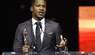 "In this April 14, 2016 file photo, Nate Parker, director of the upcoming film ""The Birth of a Nation,"" accepts the Breakthrough Director of the Year award during the CinemaCon 2016 Big Screen Achievement Awards in Las Vegas. (Photo by Chris Pizzello/Invision/AP)"