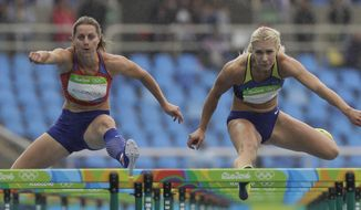 Eliska Klucinova of the Czech Republic, left, and Alina Fodorova of the Ukraine compete in a heat of the women's heptathlon 100-meter hurdles during the 2016 Summer Olympics in Rio de Janeiro, Brazil, Friday, Aug. 12, 2016. (AP Photo/David J. Phillip)