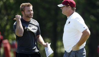 Washington Redskins offensive coordinator Sean McVay, left, talks with head coach Jay Gruden during practice at the team's NFL football training facility at Redskins Park, Wednesday, June 8, 2016 in Ashburn, Va. (AP Photo/Alex Brandon)