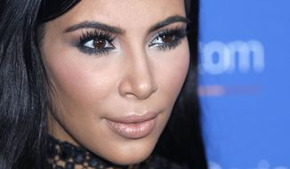 FILE - In this June 24, 2015, file photo, Kim Kardashian poses during a photo call at the Cannes Lions 2015, International Advertising Festival in Cannes, southern France. Kardashian said on Twitter August 3, 2016, that her BlackBerry smartphone died. (AP Photo/Lionel Cironneau, File)