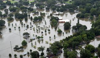 This aerial image shows flooded areas of North Baton Rouge, La., Saturday, Aug. 13, 2016. Louisiana Gov. John Bel Edwards says more than 1,000 people in south Louisiana have been rescued from homes, vehicles and even clinging to trees as a slow-moving storm hammers the state with flooding. (Patrick Dennis/The Advocate via AP)