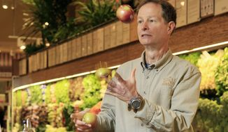 Whole Foods CEO John Mackey juggles apples as as he's photographed in one of his stores on New York's Upper West Side,  Wednesday, Nov. 18, 2009. (AP Photo/Richard Drew)