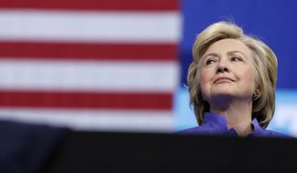 Democratic presidential candidate Hillary Clinton looks out from the stage as Vice President Joe Biden speaks at a campaign event at Riverfront Sports in Scranton, Pa., Monday, Aug. 15, 2016. (AP Photo/Carolyn Kaster)