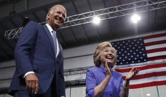 Democratic presidential candidate Hillary Clinton and Vice President Joe Biden arrive at a campaign event at Riverfront Sports in Scranton, Pa., Monday, Aug. 15, 2016. (AP Photo/Carolyn Kaster)