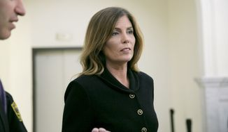 Pennsylvania Attorney General Kathleen Kane leaves the courtroom after closing arguments in her perjury and obstruction trial at the Montgomery County Courthouse, Monday, Aug. 15, 2016, in Norristown, Pa., (Jessica Griffin/The Philadelphia Inquirer via AP, Pool)