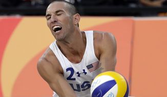 United States' Nicholas Lucena digs against Brazil during a men's beach volleyball quarterfinal match at the 2016 Summer Olympics in Rio de Janeiro, Brazil, Monday, Aug. 15, 2016. (AP Photo/Marcio Jose Sanchez)