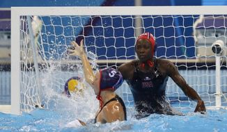 United States' Ashleigh Johnson makes a save during their women's water polo quarterfinal match against Brazil at the 2016 Summer Olympics in Rio de Janeiro, Brazil, Monday, Aug. 15, 2016. (AP Photo/Sergei Grits)