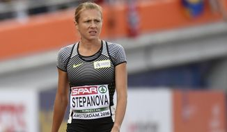 FILE - In this July 6, 2015 file photo Russian doping whistleblower Yuliya Stepanova, who ran under a neutral flag, leaves the track after suffering an injury in a women's 800m heat during the European Athletics Championships in Amsterdam, the Netherlands. Stepanova is in fear of her safety, switching residences after hackers breached a database that records her whereabouts. Stepanova and her husband, Vitaly, were the informers who detailed a state-run doping system in Russia that led to the ouster of the country's athletes from the Olympic track meet.  (AP Photo/Geert Vanden Wijngaert, File)