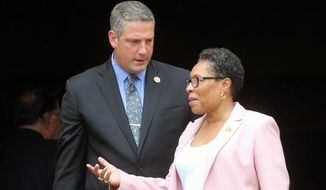 Tim Ryan and Congresswoman Marcia Fudge  talk  after the memorial service for former Ohio Congressman Steve LaTourette at the University Circle United Methodist Church Monday, Aug. 15, 2016, in Cleveland, Oio.  LaTourette died Aug. 3, 2016, after a battle with leukemia. (Gus Chan /The Plain Dealer via AP) **FILE**