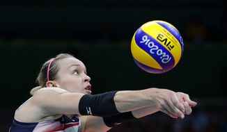 United States' Kayla Banwarth bumps during a women's quarterfinal volleyball match against Japan at the 2016 Summer Olympics in Rio de Janeiro, Brazil, Tuesday, Aug. 16, 2016. (AP Photo/Jeff Roberson)