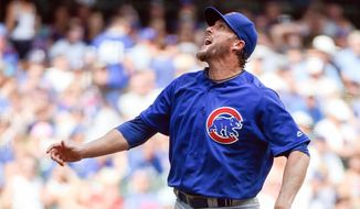 FILE - This July 24, 2016 file photo shows Chicago Cubs pitcher Joe Nathan reacting after a throw during the sixth inning of a baseball game against the Milwaukee Brewers in Milwaukee. The Giants and Nathan agreed Tuesday, Aug. 16, 2016 to a minor league contract. Nathan is attempting to extend his major league career after his second Tommy John surgery in 2015. He will report to the Giants Double-A team in Richmond. (AP Photo/Benny Sieu) **FILE**