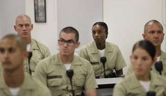 In this Tuesday, July 19, 2016, photo, Los Angeles County sheriff's deputy recruit Renata Phillip, third from right, listens to a lecture in a classroom at the Biscailuz Regional Training Center in Monterey Park, Calif. Phillip is one of just two black women in her class of 84 recruits. More than half are men and most are white or Hispanic.Only three recruits out of every 100 will make it to graduation, said Capt. Scott Gage, who's in charge of training at the Los Angeles County Sheriff's Department.  (AP Photo/Jae C. Hong)