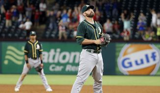 Oakland Athletics relief pitcher Marc Rzepczynski stands on the mound after hitting Texas Rangers' Rougned Odor with a pitch during the 10th inning of a baseball game with bases loaded, Tuesday, Aug. 16, 2016, in Arlington, Texas. Ian Desmond scored, giving the Rangers a 5-4 win. (AP Photo/Tony Gutierrez)